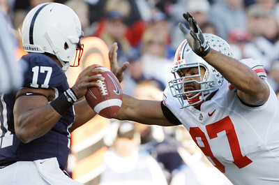 In this Saturday, Nov. 7, 2009, photo, Penn State quarterback Daryll Clark (17) looks to pass as Ohio State defensive tackle Cameron Heyward (97) moves in during the first half of an NCAA college football game in State College, Pa. Ohio State won 24-7. Ohio State got over its big-game blues by beating up on Penn State. There's little time to rest, though: Iowa is coming to the Horseshoe next with first place in the Big Ten on the line. (AP Photo/Carolyn Kaster)