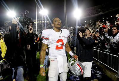 Ohio State quarterback Terrelle Pryor (2) celebrates their win over Penn State with fans after an NCAA college football game in State College, Pa., Saturday, Nov. 7, 2009. Ohio State won 24-7. (AP Photo/Carolyn Kaster)