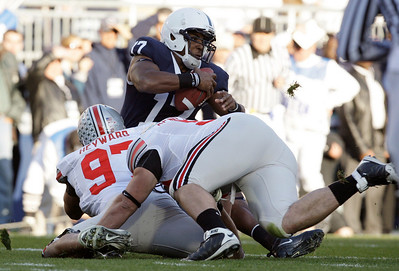 Ohio State's Cameron Heyward (97) andTodd Denlinger (92) sack Penn State quarterback Daryll Clark (17) during the first half of an NCAA college football game in State College, Pa., Saturday, Nov. 7, 2009. (AP Photo/Carolyn Kaster)