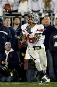 Ohio State wide receiver DeVier Posey (8) catches a pass for a touchdown against Penn State during the second half of an NCAA college football game in State College, Pa., Saturday, Nov. 7, 2009. (AP Photo/Carolyn Kaster)