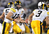 Sep 26, 2009; State College, PA, USA; Iowa Hawkeyes quarterback Ricky Stanzi (12) hands off to running back Brandon Wegher (3) against the Penn State Nittany Lions during the second half at Beaver Stadium. The Hawkeyes beat the Nittany Lions 21-10. Mandatory Credit: Don McPeak-US PRESSWIRE
