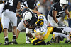 Sep 26, 2009; State College, PA, USA; Penn State Nittany Lions running back Evan Royster (22) is tackled by Iowa Hawkeyes linebacker Pat Angerer (43) during the first half at Beaver Stadium. The Hawkeyes beat the Nittany Lions 21-10. Mandatory Credit: Don McPeak-US PRESSWIRE
