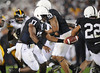 Sep 26, 2009; State College, PA, USA; Penn State Nittany Lions quarterback Daryll Clark (17) hands off to running back Evan Royster (22) in a game against the Iowa Hawkeyes during the first half at Beaver Stadium. Mandatory Credit: Don McPeak-US PRESSWIRE