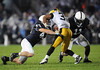 Sep 26, 2009; State College, PA, USA; Iowa Hawkeyes running back Adam Robinson (32) is tackled by Penn State Nittany Lions linebackers Josh Hall (43) and Navarro Bowman (11) during the second half at Beaver Stadium. The Hawkeyes beat the Nittany Lions 21-10. Mandatory Credit: Don McPeak-US PRESSWIRE