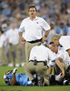 Sep 3, 2009; Nashville, TN, USA; Tennessee Titans head coach Jeff Fisher stands over injured Titans running back Quinton Ganther (35) during the first half against the Green Bay Packers at LP Field. The Titans beat the Packers 27-13. Mandatory Credit: Don McPeak-US PRESSWIRE