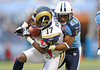 Dec 13, 2009; Nashville, TN, USA; Tennessee Titans corner back Nick Harper (20) tackles St Louis Rams wide receiver Donnie Avery (17) during the first half at LP Field. The Titans beat the Rams 47-7. Mandatory Credit: Don McPeak-US PRESSWIRE