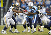 Dec 13, 2009; Nashville, TN, USA; Tennessee Titans running back Chris Johnson (28) breaks a tackle by St Louis Rams Ron Bartell (24) during the first half at LP Field. Mandatory Credit: Don McPeak-US PRESSWIRE