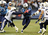 Dec 25, 2009; Nashville, TN, USA; Tennessee Titans running back Chris Johnson (28) runs with the ball against San Diego Chargers linebacker Brandon siler (59) during the first half at LP Field. Mandatory Credit: Don McPeak-US PRESSWIRE