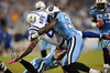 Oct 11, 2009; Nashville, TN, USA; Tennessee Titans cornerback Jason McCourty (30) tackles Indianapolis Colts wide receiver Reggie Wayne (87) during the first half at LP Field. Mandatory Credit: Don McPeak-US PRESSWIRE
