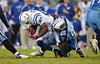 Oct 11, 2009; Nashville, TN, USA; Indianapolis Colts wide receiver Reggie Wayne (87) is tackled by Tennessee Titans linebacker Stephen Tulloch (55) during the second half at LP Field. The Colts beat the Titans 31-9. Mandatory Credit: Don McPeak-US PRESSWIRE