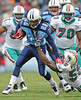Dec 20, 2009; Nashville, TN, USA; Tennessee Titans running back Chris Johnson (28) is grabbed by Miami Dolphins linebacker Joey Porter (55) during the first half at LP Field. Mandatory Credit: Don McPeak-US PRESSWIRE