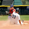 "Rocky Mountain Hit Club's Steve Heyliger slides into second base safely under the tag of Colorado Twins infielder Marcus Steward on Saturday, July 30, during a baseball game at Scott Carpenter Park in Boulder. Rocky Mountain Hit Club won the game 18-5. For more photos go to  <a href=""http://www.dailycamera.com"">http://www.dailycamera.com</a><br /> Jeremy Papasso/ Camera"