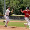 "Rocky Mountain Hit Club's Hayden Underberg, left, tosses the ball to the third baseman as he tries for an out on Colorado Twins runner Dylan Kaczeus during a pickle situation on Saturday, July 30, during a baseball game at Scott Carpenter Park in Boulder. Rocky Mountain Hit Club won the game 18-5. For more photos go to  <a href=""http://www.dailycamera.com"">http://www.dailycamera.com</a><br /> Jeremy Papasso/ Camera"