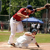 "Rocky Mountain Hit Club's Fred Good slides back to third safely under the tag of Colorado Twins third baseman Taylor Keller on Saturday, July 30, during a baseball game at Scott Carpenter Park in Boulder. Rocky Mountain Hit Club won the game 18-5. For more photos go to  <a href=""http://www.dailycamera.com"">http://www.dailycamera.com</a><br /> Jeremy Papasso/ Camera"
