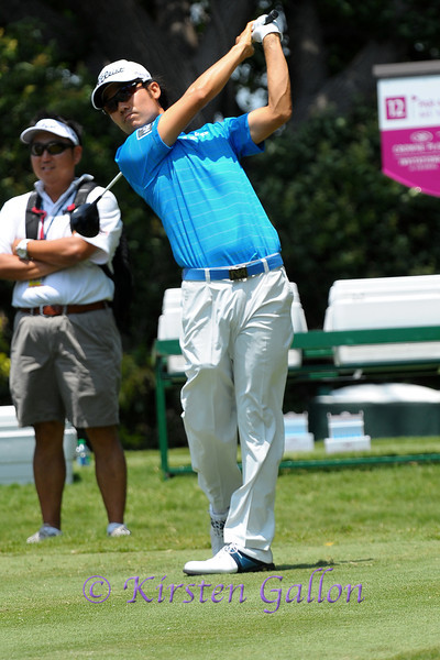 Kevin Na watches the ball as it sails down the fairway after teeing off.