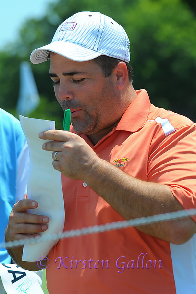 Louis Oosthuizen blowing the ink dry on his scorecard.