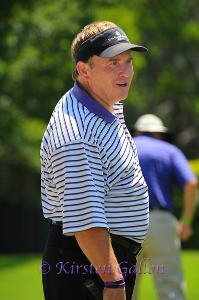 TCU Coach Gary Patterson gets ready to tee off.  He was part of J.J. Henry's group.