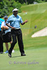 Vijay Singh tosses the ball to himself by way of his putter.