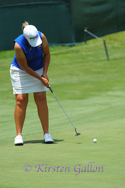 LPGA player Angela Stanford making her putt on the 13th green.