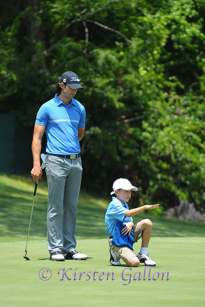 Cameron Tringale getting some advice on how to play the lie of the ball on the 13th green.