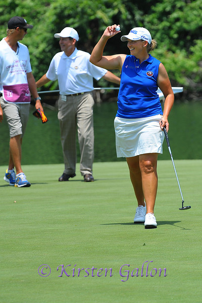 Angela Stanford salutes the crowd after making her putt.