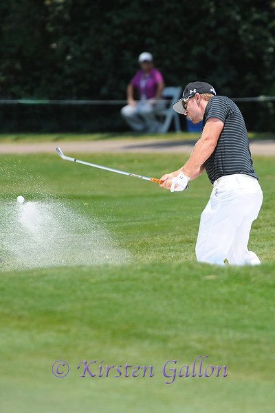Hunter Mahan hits it out of the sand trap.