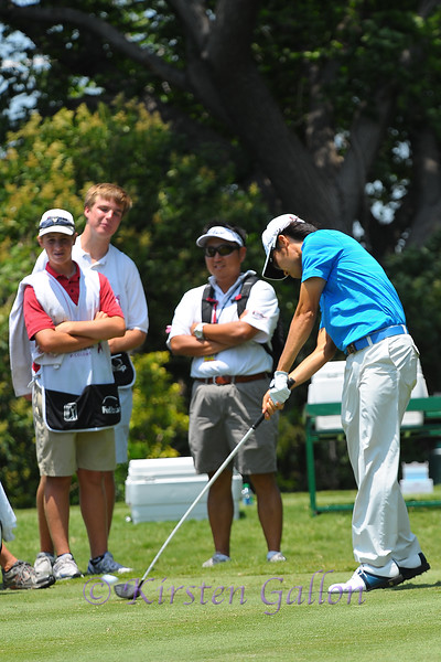 Kevin Na's ball comes of the driver as he tees off.