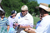 JOHN DALY signs autographs for the crowd.