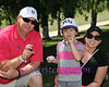 CHRIS MILTON, REESE MILTON AND AILEEN MILTON show some Horned Frog spirit after Coach Gary Patterson gave Reese one of his Horned Frog golf balls.<br /> COLONIAL PRO AM 2013