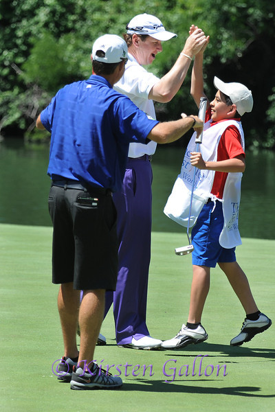 JJ HENRY,  LENNY ESPINOZA<br /> Lenny Espinoza gets a high five from JJ Henry after making the putt in JJ's place.<br /> COLONIAL PRO AM 2013