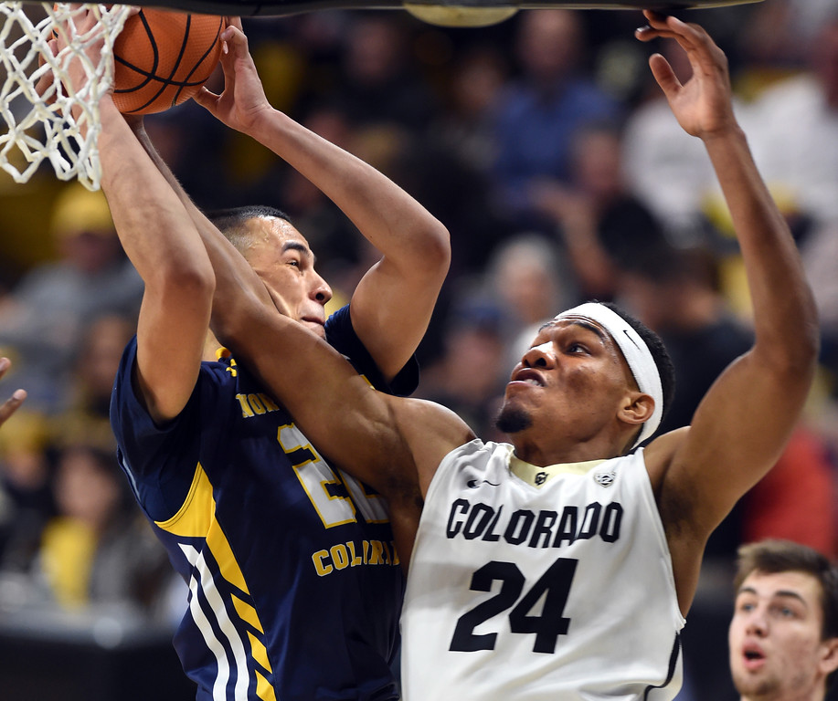 . George King, right, of CU, tries to get the rebound from Jalen Sanders, of UNC, during the November 10th, 2017 game in Boulder.  Cliff Grassmick / Staff Photographer/ November 10, 2017, 2017