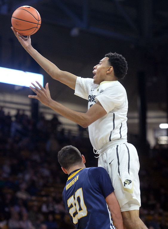 . Deleon Brown, of CU drives on Tanner Morgan, of UNC, during the November 10th, 2017 game in Boulder.  Cliff Grassmick / Staff Photographer/ November 10, 2017, 2017