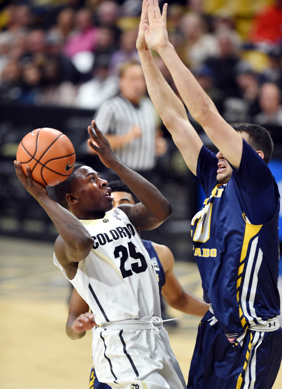 . McKinley Wright IV, of CU, drives on Tanner Morgan, of UNC, during the November 10th, 2017 game in Boulder.  Cliff Grassmick / Staff Photographer/ November 10, 2017, 2017