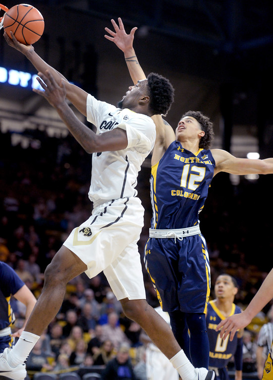 . Namon Wright, of CU, drives past Jonah Radebaugh, of UNC, during the November 10th, 2017 game in Boulder.  Cliff Grassmick / Staff Photographer/ November 10, 2017, 2017