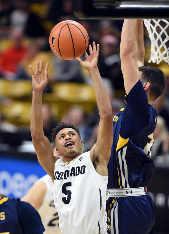 . Deleon Brown, of CU, goes up on Tanner Morgan, of UNC, during the November 10th, 2017 game in Boulder.  Cliff Grassmick / Staff Photographer/ November 10, 2017, 2017