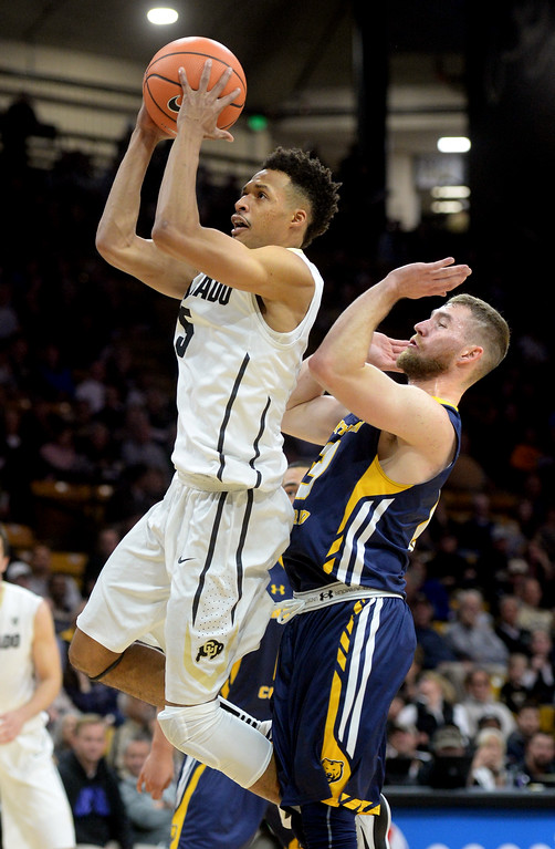 . Deleon Brown, of CU drives on Chaz Glotta, of UNC,during the November 10th, 2017 game in Boulder.  Cliff Grassmick / Staff Photographer/ November 10, 2017, 2017