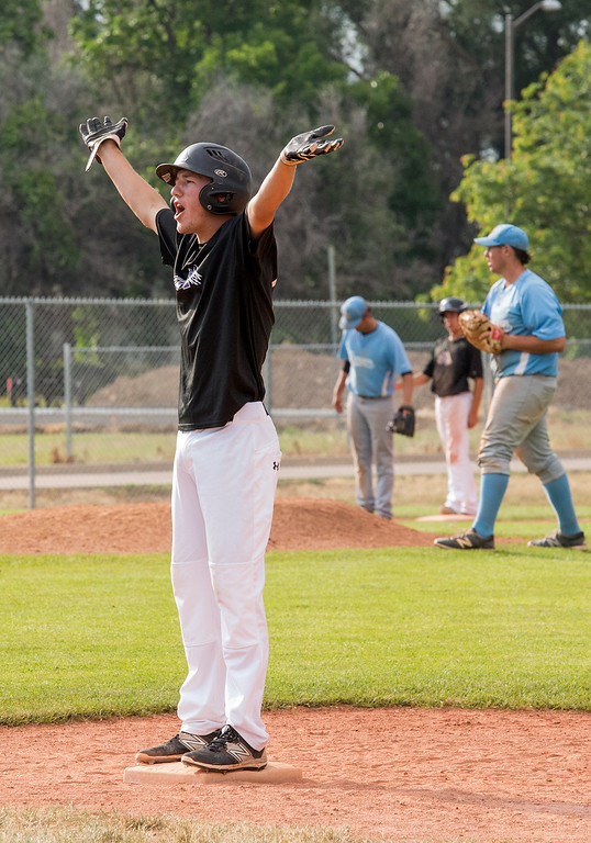 . Mountain View\'s Dylan Norsen (17) celebrates loading the bases in the bottom of the 7th inning against Mountain Range Friday afternoon July 15, 2016 during the Colorado Baseball League State Tournament at Brock Field in Loveland. Mountain View won the game, 4-3. (Photo by Michael Brian/Loveland Reporter-Herald)