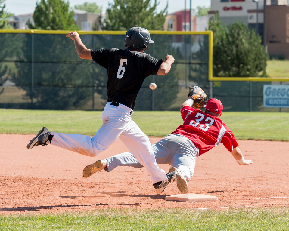 . Mountain View\'s Easton Madrid (6) gets safely to first base Thursday morning July 14, 2016 after an errant throw pulls Colorado Bandits first baseman Chris Grattino (33) off the bag during the Colorado Baseball League State Tournament at Brock Field in Loveland. (Photo by Michael Brian/Loveland Reporter-Herald)