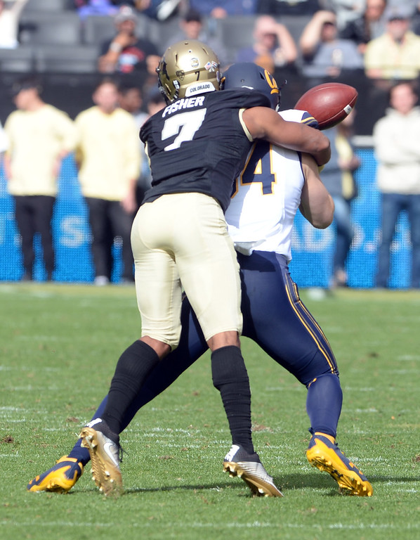 . Nick Fisher, of CU, breaks up a pass during the CU Cal Homecoming game on Saturday.  Cliff Grassmick / Staff Photographer/ October 28, 2017