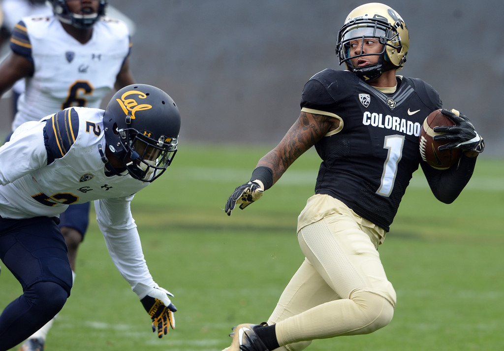 . Shay Fields, of CU, scores a TD on this catch past Darius Allensworth, of Cal, during the CU Cal Homecoming game on Saturday.  Cliff Grassmick / Staff Photographer/ October 28, 2017