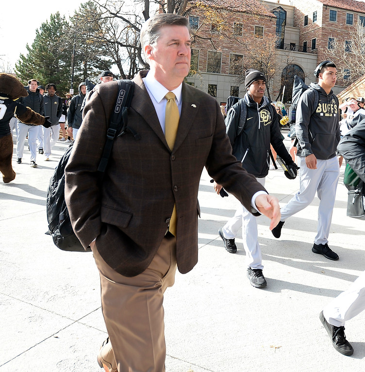 . CU Buff head coach, Mike MacIntyre, along the CU Buff Walk before the CU Cal Homecoming game on Saturday.  Cliff Grassmick / Staff Photographer/ October 28, 2017