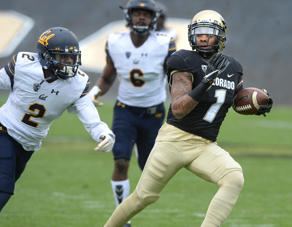 . Shay Fields, of CU, catches a TD past Darius Allensworth, of Cal, during the CU Cal Homecoming game on Saturday.  Cliff Grassmick / Staff Photographer/ October 28, 2017