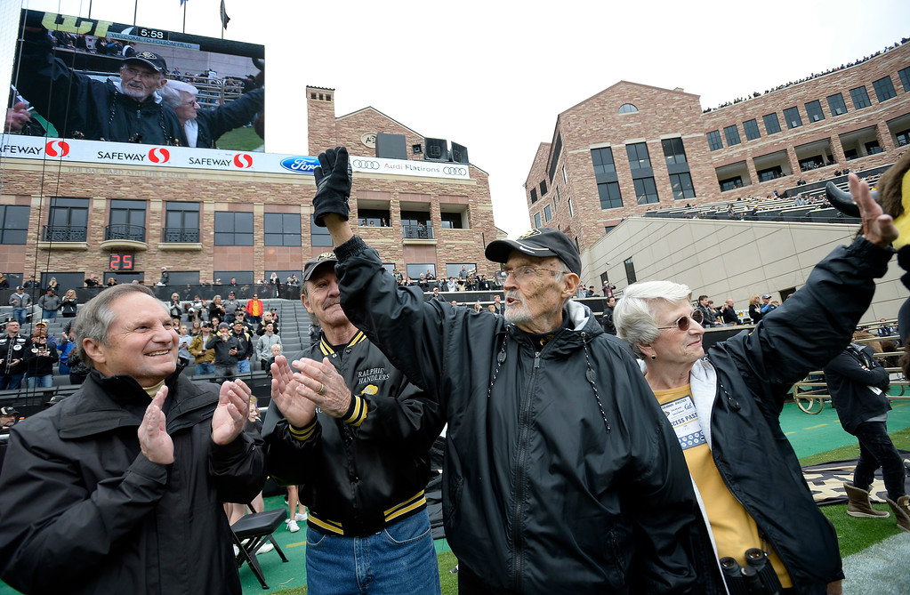 . Long-time voice of the CU Buffs, Alan Cass, and his wife Sue, wave to the crowd during the CU Cal Homecoming game on Saturday.  Cliff Grassmick / Staff Photographer/ October 28, 2017