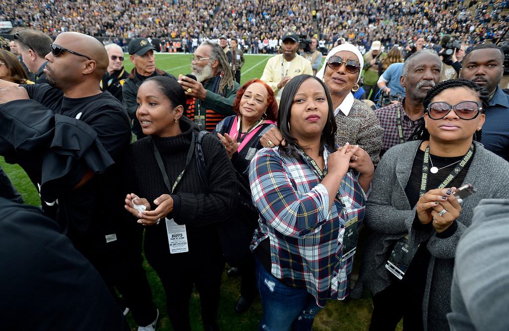 . Family and friends of Rashaan Salaam, look up to see his number being retired inside the stadium, during the CU Cal Homecoming game on Saturday.  Cliff Grassmick / Staff Photographer/ October 28, 2017