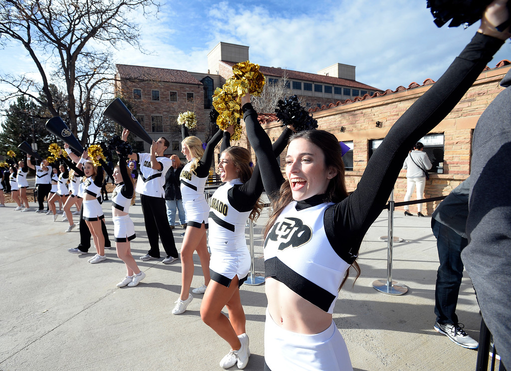 . The CU Spirit Team waits for the players along the Buff Walk before the CU Cal Homecoming game on Saturday.  Cliff Grassmick / Staff Photographer/ October 28, 2017