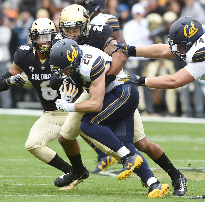 . Drew Lewis, of CU, tackles Patrick Laird, of Cal, during the CU Cal Homecoming game on Saturday.  Cliff Grassmick / Staff Photographer/ October 28, 2017