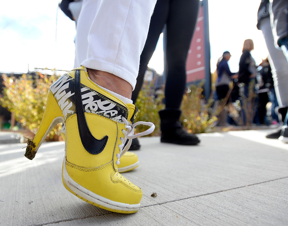 . A woman wears CU Buff shoes before the CU Cal Homecoming game on Saturday.  Cliff Grassmick / Staff Photographer/ October 28, 2017