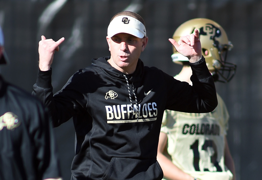 . CU co-offensive coordinator, Brian Lindgren, works with quarterbacks during the first day of Spring football at the University of Colorado. For more photos, go to www.buffzone.com. Cliff Grassmick  Staff Photographer  February 22, 2017