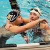 Monarch High School senior Anna Labozan, left, hugs Regis Jesuit senior Hillary Thomas after winning the 100 Yard Freestyle on Saturday, Dec. 18, during the Colorado Coaches Invite at Mountain View High School in Loveland. Labozan's winning time was 51.40.<br /> Jeremy Papasso/Camera