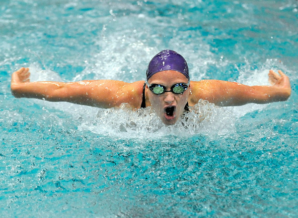 Boulder High School junior Jennifer Harrison gasps for air during her 100 Yard Butterfly race on Saturday, Dec. 18, during the Colorado Coaches Invite at Mountain View High School in Loveland. Harrison finished 14th with a time of 1:00.97.<br /> Jeremy Papasso/Camera